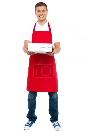 Photo for Full length portrait of male chef holding pie box isolated against white background - Royalty Free Image