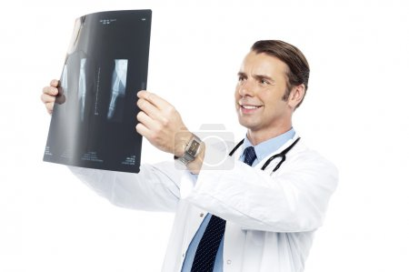 Experienced orthopedic surgeon reviewing x-ray report