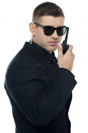 Chief security officer communicating through his walkie-talkie