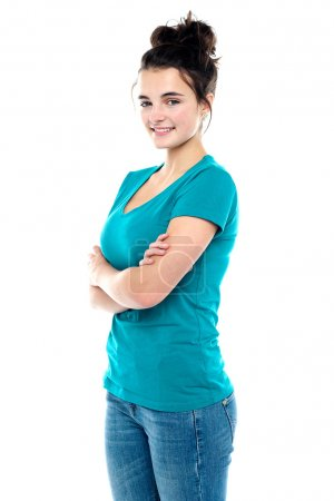 Photo for Charming young caucasian pretty teenager posing confidently with folded arms - Royalty Free Image