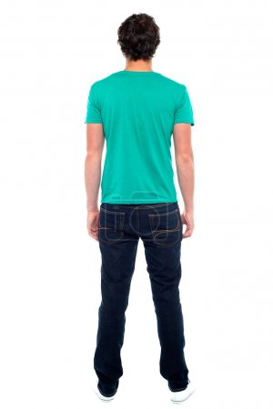 Rear view of teen guy in casuals