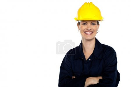 Photo for Beaming construction worker wearing yellow safety helmet. Cheerful portrait - Royalty Free Image