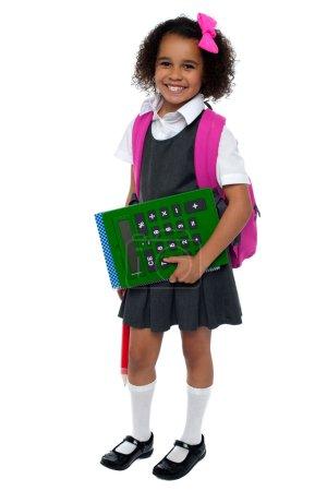 Pretty doll is ready for school