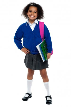 Girl in smart uniform holding notebook and calculator