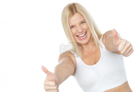 Tilted image of cheerful lady showing thumbs up