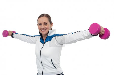 Woman holding dumbbells in her outstretched arms
