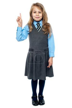 School girl raising hand