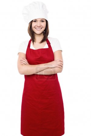 Photo for Confident young female chef with folded arms. - Royalty Free Image