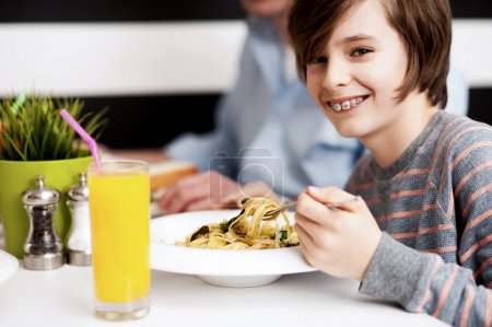 Boy enjoying food and fresh juice