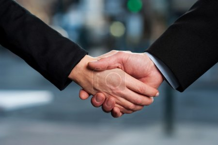 The deal is on. Business handshake