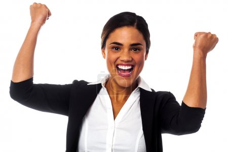 Excited woman with clenched fists