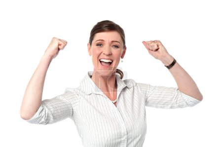 Excited corporate lady with clenched fists