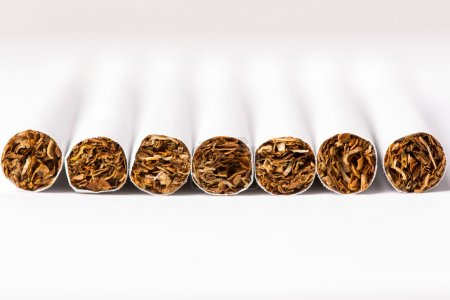 Cigarettes arranged in a row, a background