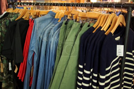 Fashion clothing on hangers in a shop