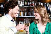 Couples enjoying drinks in nightclub