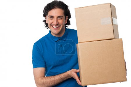 Man carrying couple of cardboard boxes