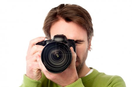 Photo for Man with digital SLR camera isolated over white - Royalty Free Image