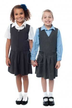 Smiling girls in school uniform