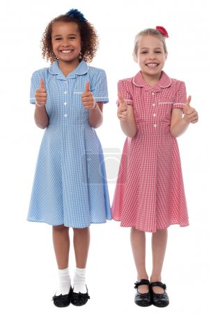 Cheerful girls showing double thumbs up