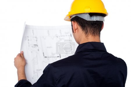 Civil engineer reviewing blueprint