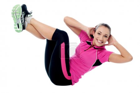 Photo for Athletic young woman doing crunches - Royalty Free Image