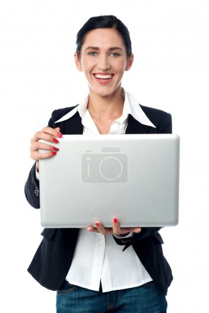 Photo for Cheerful corporate executive browsing on laptop - Royalty Free Image