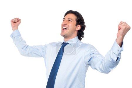 Photo pour Entrepreneur réussi serrant les poings - image libre de droit
