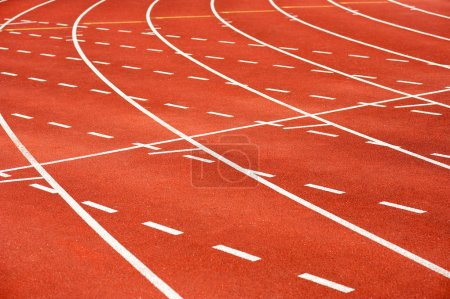Photo for Red running track with curvy lanes - Royalty Free Image