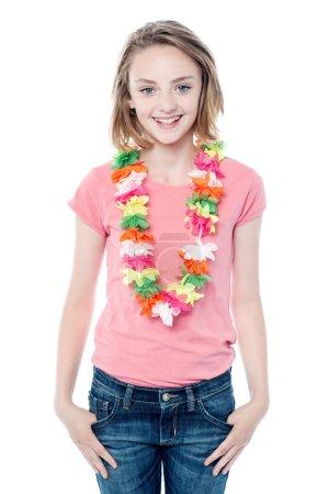 Pretty young girl wearing garland