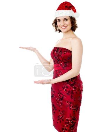 Female santa showing welcome gesture