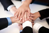 Group of business people joining hands