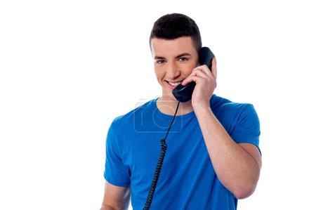 Smart man using telephone