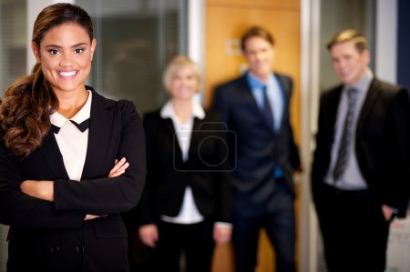 Photo for Friendly business people with female leader in front - Royalty Free Image