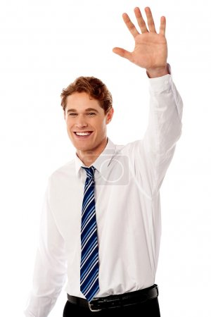 Businessman waving hi to his colleague
