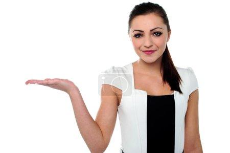 Pretty businesswoman presenting something
