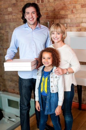 Little girl with parents posing casually