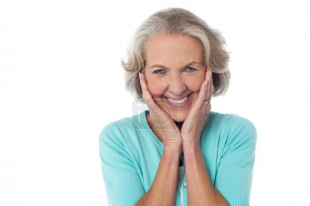 Photo for Cheerful old woman with hands on her cheeks - Royalty Free Image