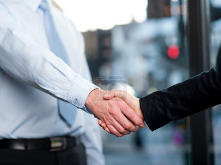 Close-up of business people handshaking