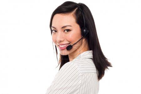 Foto de Mujer alegre llamada Centro Ejecutivo con auricular - Imagen libre de derechos