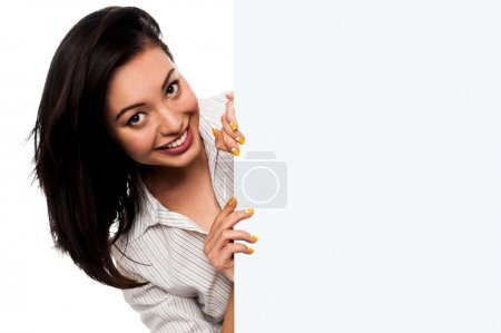 Photo for Attractive young woman holding blank banner ad - Royalty Free Image