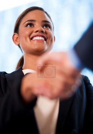 Photo for Welcoming business woman giving a handshake - Royalty Free Image