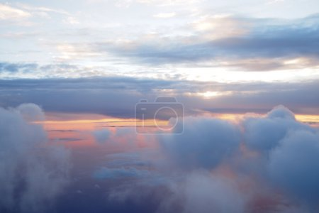 Sunrise above clouds during a flight