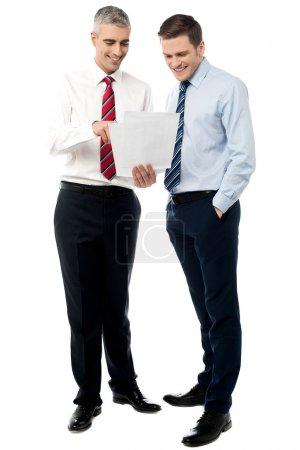 Young executives discussing business reports