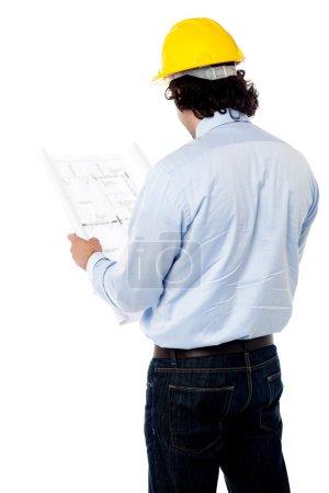 Civil engineer analyzing construction plan