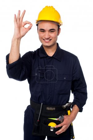 Young male worker giving the ok sign