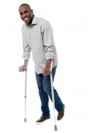 Man with crutches trying to walk