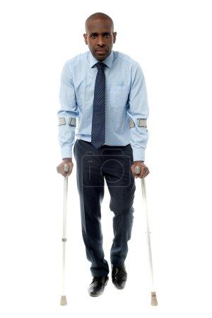 African businessman man with crutch