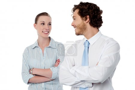 Business couple with arms crossed