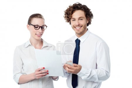 Business executives analyzing report