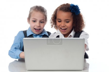 School girls using laptop together